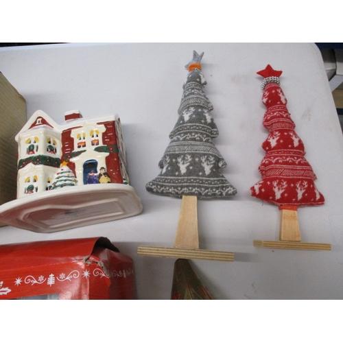 35 - Christmas assortment to include crackers, christmas bear, santa, ornamental trees etc....