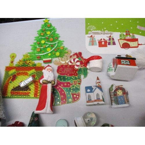 36 - Christmas assortment to include snowman, ornamental christmas trees, santa hat, christmas cottages e...
