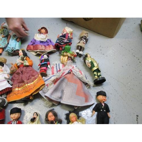 59 - Quantity of costume dolls to include Romania, Australia, Virgin Islands, Holland, etc. Approx 32...