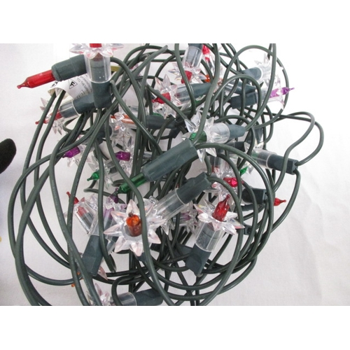 41 - Christmas themed selection comprising of quantity of tinsel, fairy lights, light up fibre optic ange...