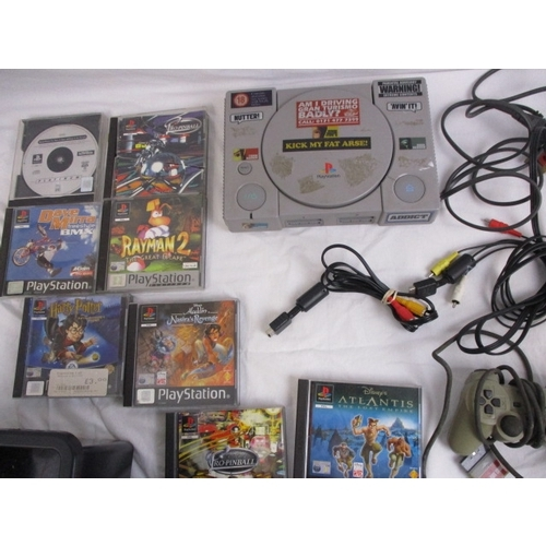 60 - Playstation 1 bundle, with 1 controller and leads, plus 8 games, Rayman 2, Toystory, Harry Potter, e...