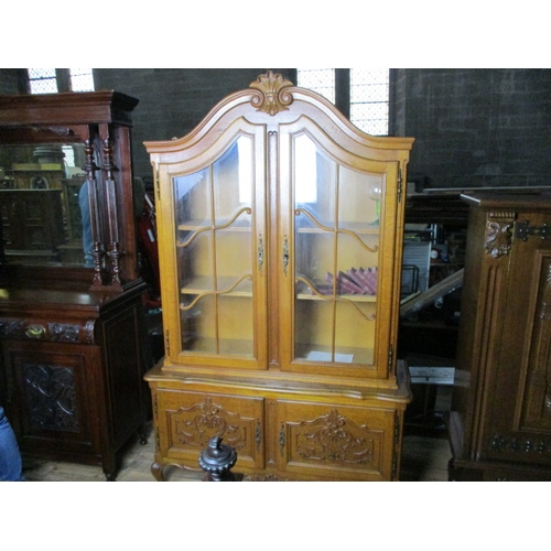 12 - Louis XV style golden oak display cabinet 2 glass wood detailed doors with key and 2 lower wooden do...