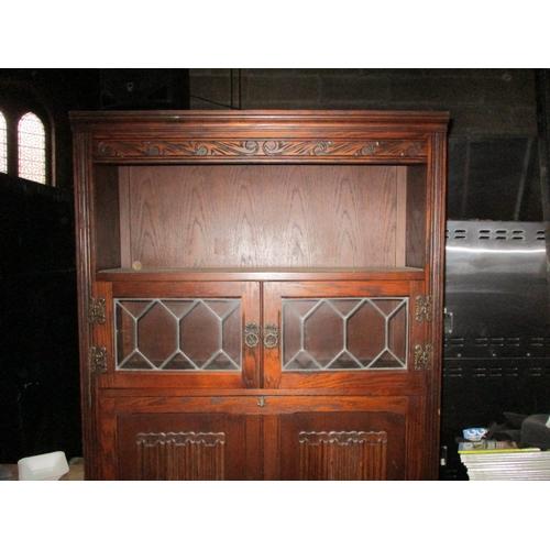 19 - Oak display cabinet with 2 small lead glass doors, over drop down door, above 2 door cupboard. 74