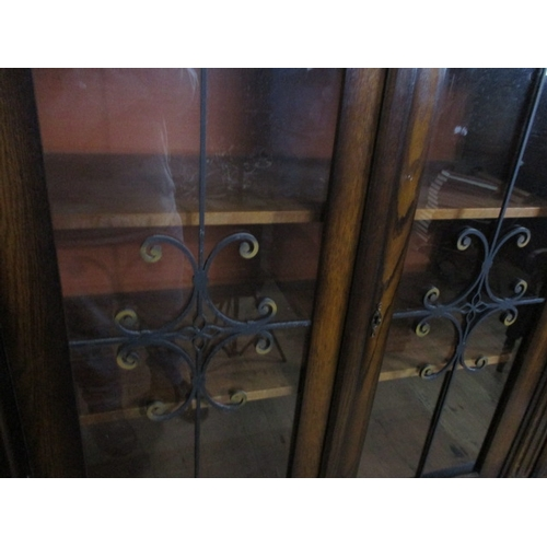 22 - French style oak unit with flemish style decoration, 2 centre leaded glass doors between 2 outer woo...