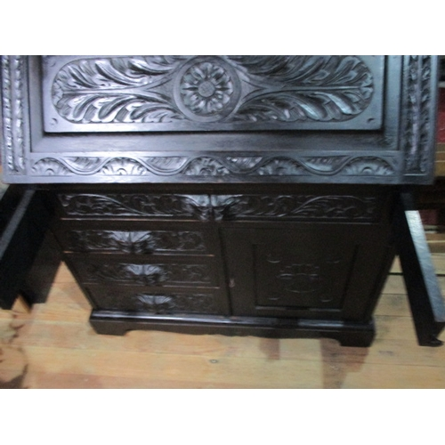 23 - Greenman style bureau with 3 small drawers aside a cupboard door, above is a larger drawer, which is...