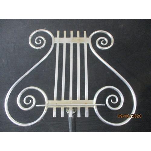45 - Adjustable music stand....