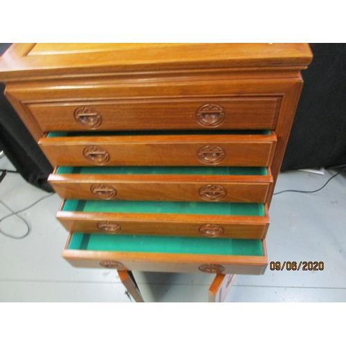 46 - Oriental design cabinet, 5 drawers, two door bottom cupboard....