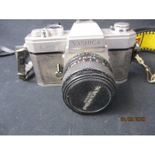 47 - Vintage pair of Yashica cameras FR1 & FX2, with lens and booklets....