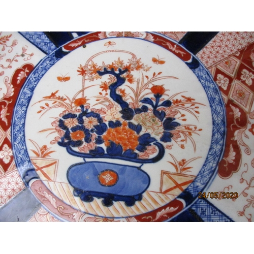 51 - Large Imari scalloped edge porcelain charger, 18 inch. Wheel  of fortune design and decorated verso...