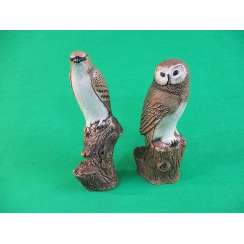 11 - A pair of vintage plaster birds of prey...