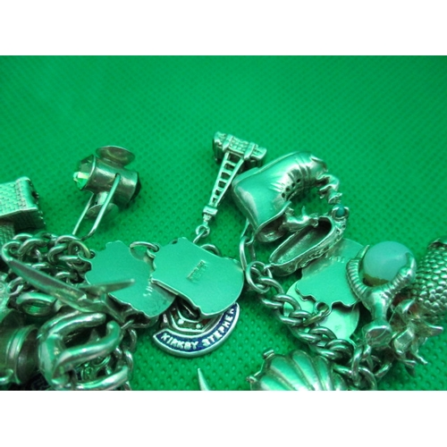 52 - Vintage silver charm bracelet with 23 charms...