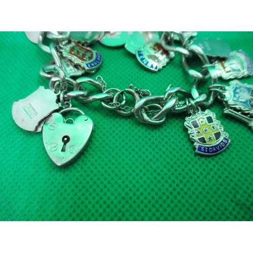 54 - Vintage silver charm bracelet with 25 charms...