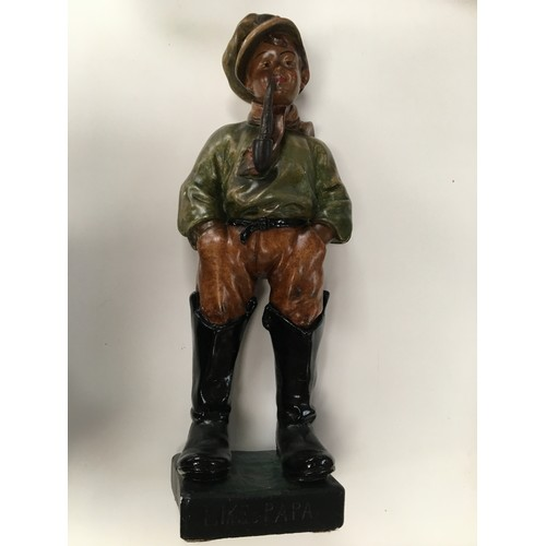 49 - Large painted plaster figure of boy in boots with a pipe entitled like papa....