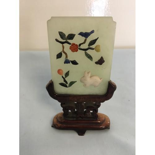 55 - Miniature Jade screen on hardwood stand, set with semi-precious carvings....
