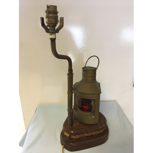 84 - Lamp in the form of a brass Port ships lamp with a rope edged pulley base....