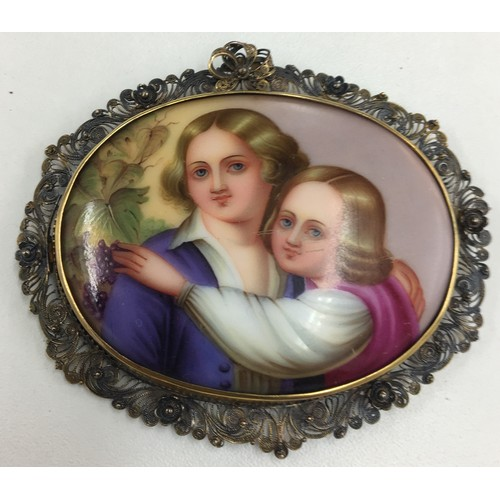 117 - Painted large brooch of two children in silver filigree surround....