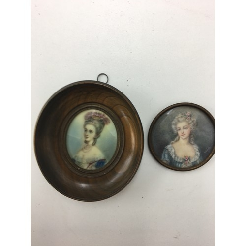 171 - Two miniature portraits of women....