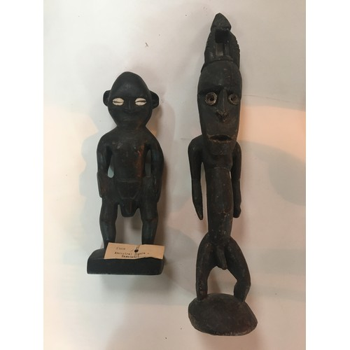 175 - Two 19th c African carved ancestral figures with Cowrie shell eyes....