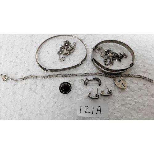 121a - Assortment of silver including cross pendant on chain, 2 silver bangles etc (34gms)