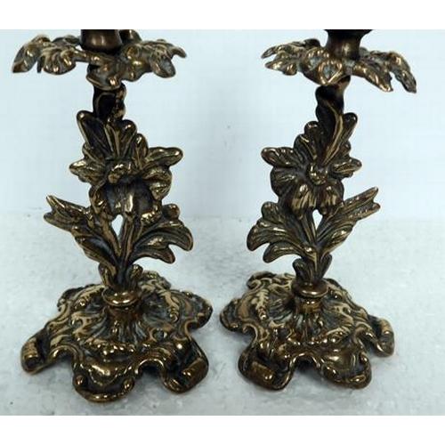 167 - Pair of ornate brass candlesticks