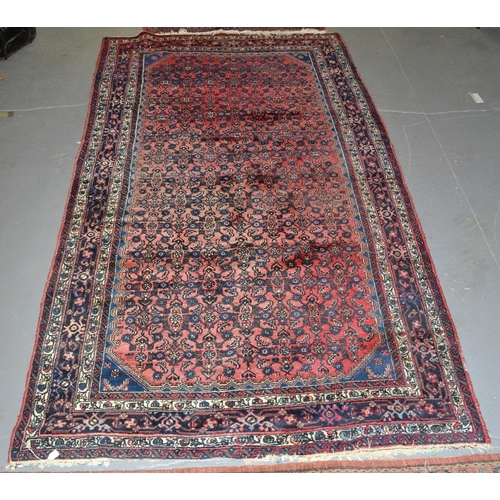 2 - A large vintage red ground Qashqai style rug - approx 10 ft x 5 ft 6