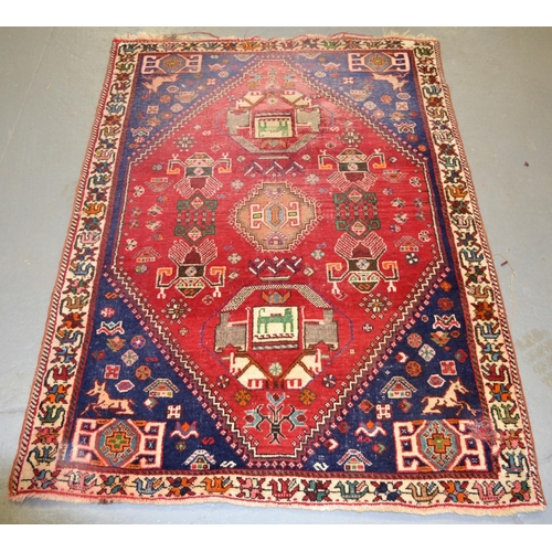 12 - An unusual red and blue ground rug - approx 4ft 5