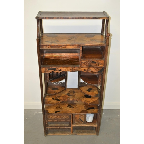 16 - A late 19th/ Early 20th century Japanese specimen wood parquetry floor standing side cabinet. Approx...