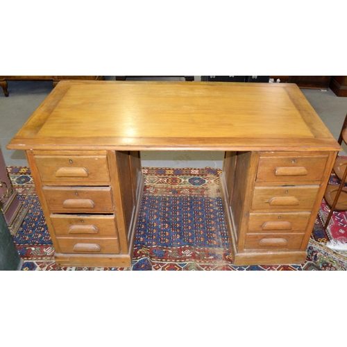 31 - An Art Deco period light oak pedestal desk...