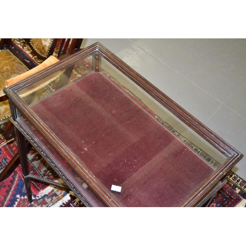 28 - A Victorian Bijouterie table with glazed top...
