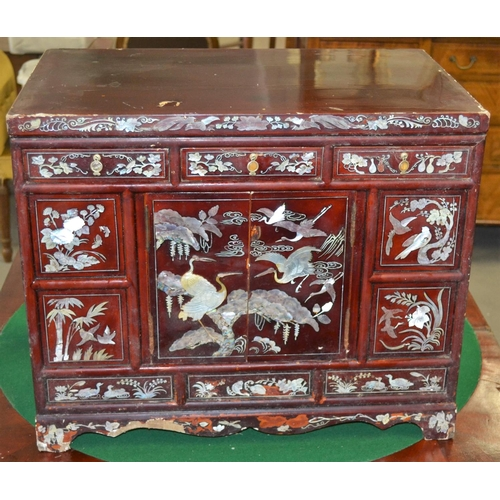 35 - An unusual red lacquer and mother of pearl inlaid cabinet. Believed to be Korean c.1920...