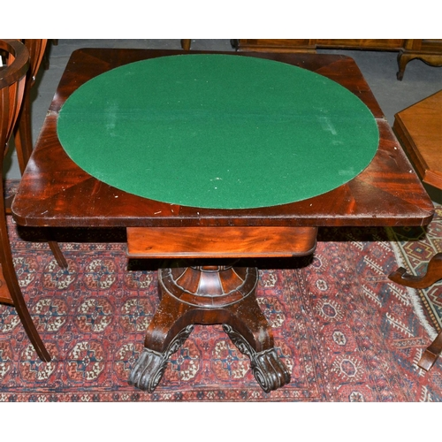 35a - A Victorian Rosewood fold over card table with a highly decorative base...