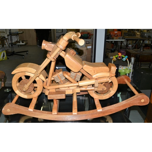 26 - An unusual wooden rocking motorcycle...