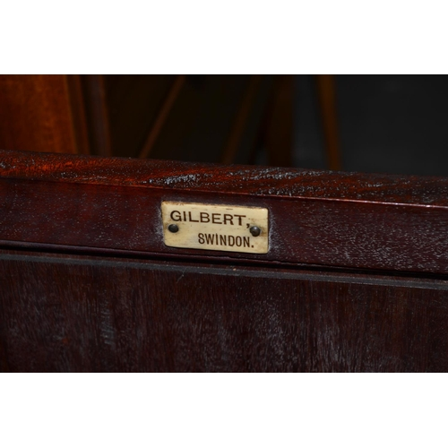 22 - A vintage mahogany bedside cupboard by Gilbert of Swindon...