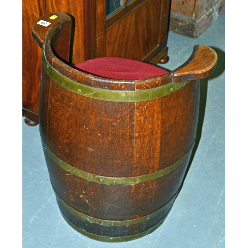 36 - An unusual vintage coopered wooden barrel converted into a tub chair...