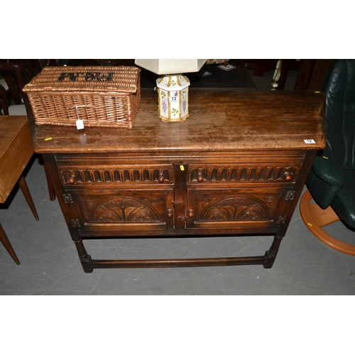 12 - Carved oak sideboard...