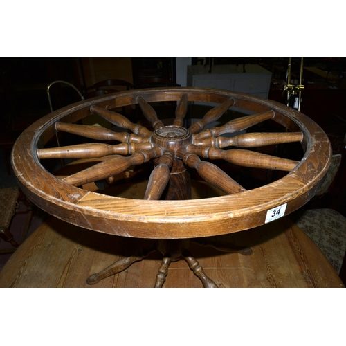 34 - Cart wheel style topped table lacking glass...