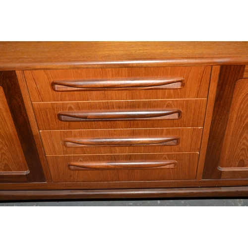 35 - A large G-Plan Teak sideboard with 2 double cupboards and 4 drawers...