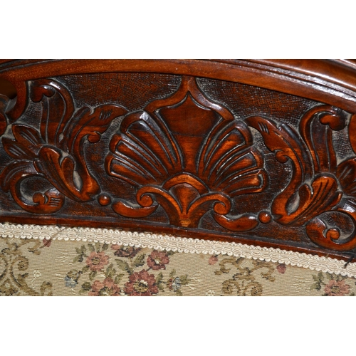53 - A pair of Edwardian carved wooden chairs...