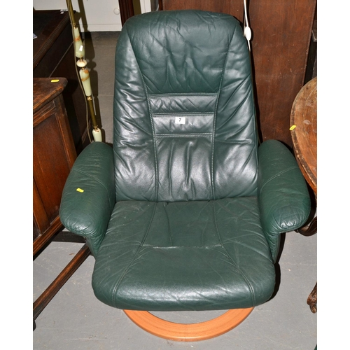 7 - A green leather Unico lazy-boy style armchair...