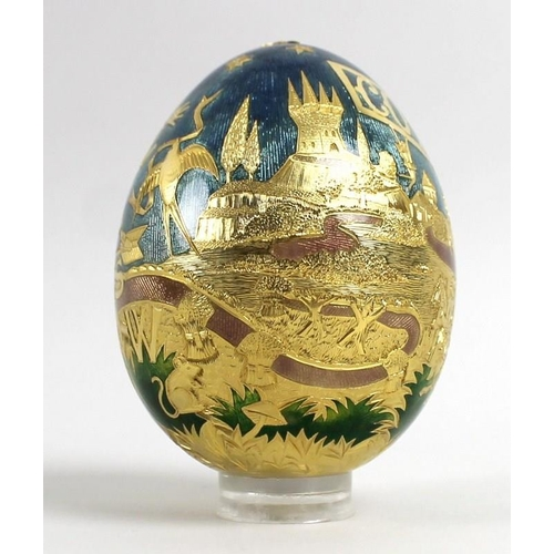 830 - A large 22ct gold Cadbury's 'Conundrum' egg, by Garrard & Co, London, finely engraved and enamelled ...