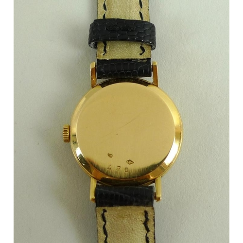 836 - A lady's Cartier 18K gold cased wristwatch, circular white dial with black Roman numerals and minute...