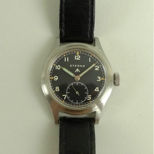 893 - A WWII Eterna steel cased 'Dirty Dozen' military wristwatch, black dial with subsidiary seconds dial...