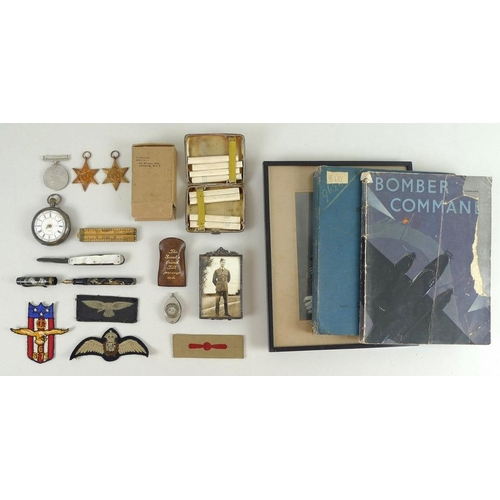 668 - A group of military related items, including a silver cigarette case with eight 'Players Medium Navy...