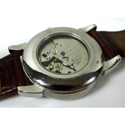 838 - A Robert Loomes Stamford First Edition steel cased gentleman's wristwatch, the circular dial with bl...