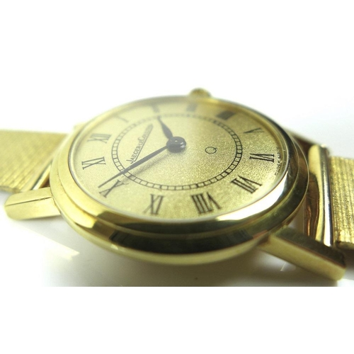845 - A lady's Jaeger Le Coultre 18ct gold wristwatch with 9ct gold bracelet strap, circular gold dial wit...