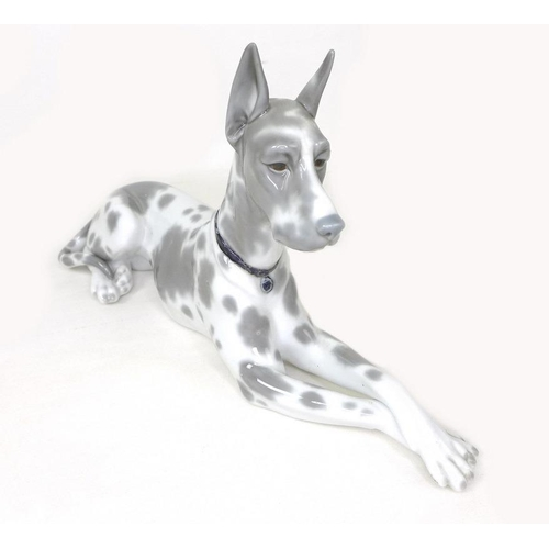 513 - Two Lladro figurines of dogs, one a Great Dane, 1068, 30 by 17cm, the other a Basset Hound, 1066, 20...