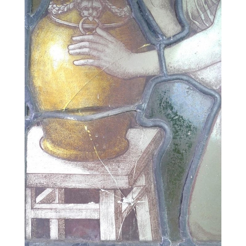 547 - A pair of 18th century stained glass windows, each painted with a female figure, likely a Muse, one ...
