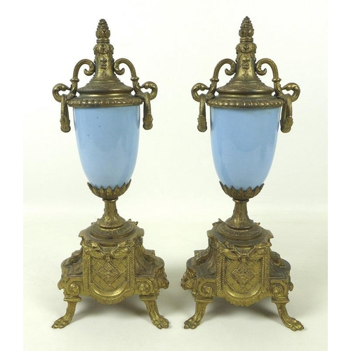 716 - A French clock garniture with striking movement, and Roman numerals, the ceramic case richly decorat...