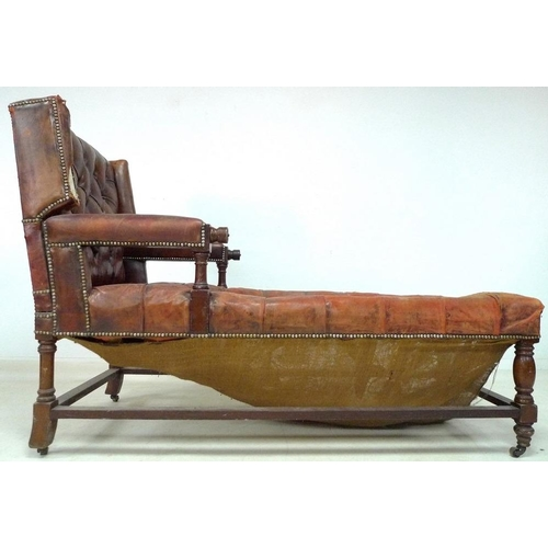 920 - A Victorian mahogany framed day bed, with padded open arms, the squared back with small wings reclin...