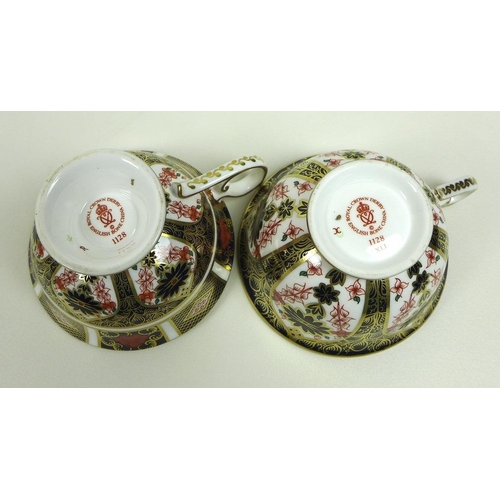 506 - A collection of Royal Crown Derby bone china, Imari pattern 1128, comprising dinner plate, side plat...